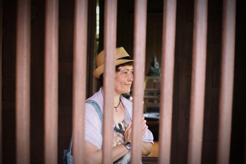 Smiling woman seen through railing