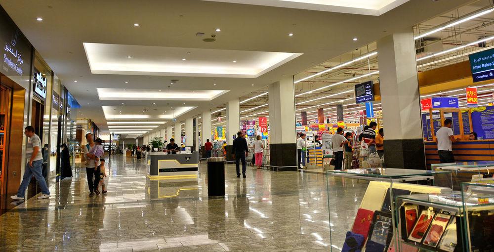 Dubai Shopping Mall Architecture Choice Consumerism Day Dubai Supermarket Illuminated Indoors  Large Group Of People Lighting Reflections Market Modern People Retail  Shiny Floor Store Travel Magazine Website Design