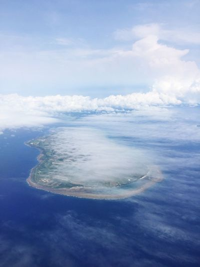 Island from the sky Island Cloud - Sky Sky Beauty In Nature Scenics - Nature Water Sea Nature Beach Waterfront Blue