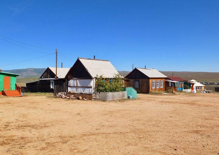 Houses against clear blue sky