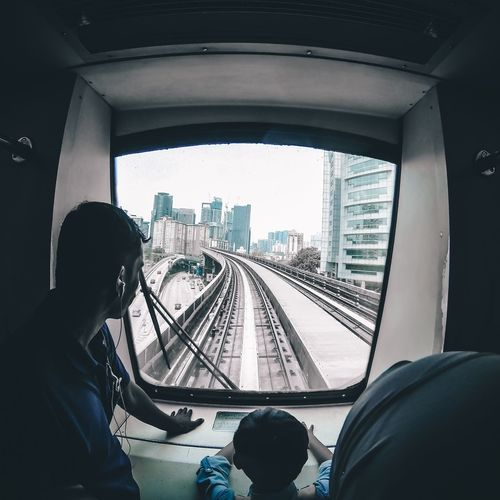 Real People Vehicle Interior Transportation Railroad Track Rail Transportation Lifestyles Day Mode Of Transport Travel Indoors  City Malaysia Vacation Bukitbintang
