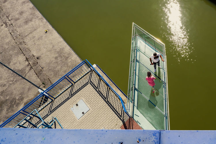 High angle view of people by lake