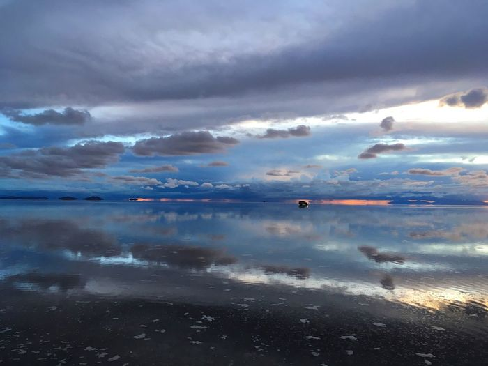 A Speck of Time Cloud - Sky Water Sky Beauty In Nature Reflection Scenics - Nature Creative Space Tranquil Scene Nature Non-urban Scene No People Idyllic Horizon Over Water Outdoors