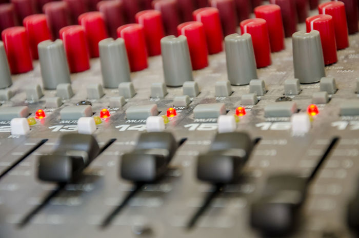 A close up view of a sound mixing desk. Buttons Channels Close-up Control Panel Day Dials Full Frame In A Row Indoors  Knobs LEDs Levels Mixing Mixing Desk Music Musical Instrument No People Recording Studio Sliders Sound Sound Desk Sound Mixer Sound Recording Equipment Switches Technology