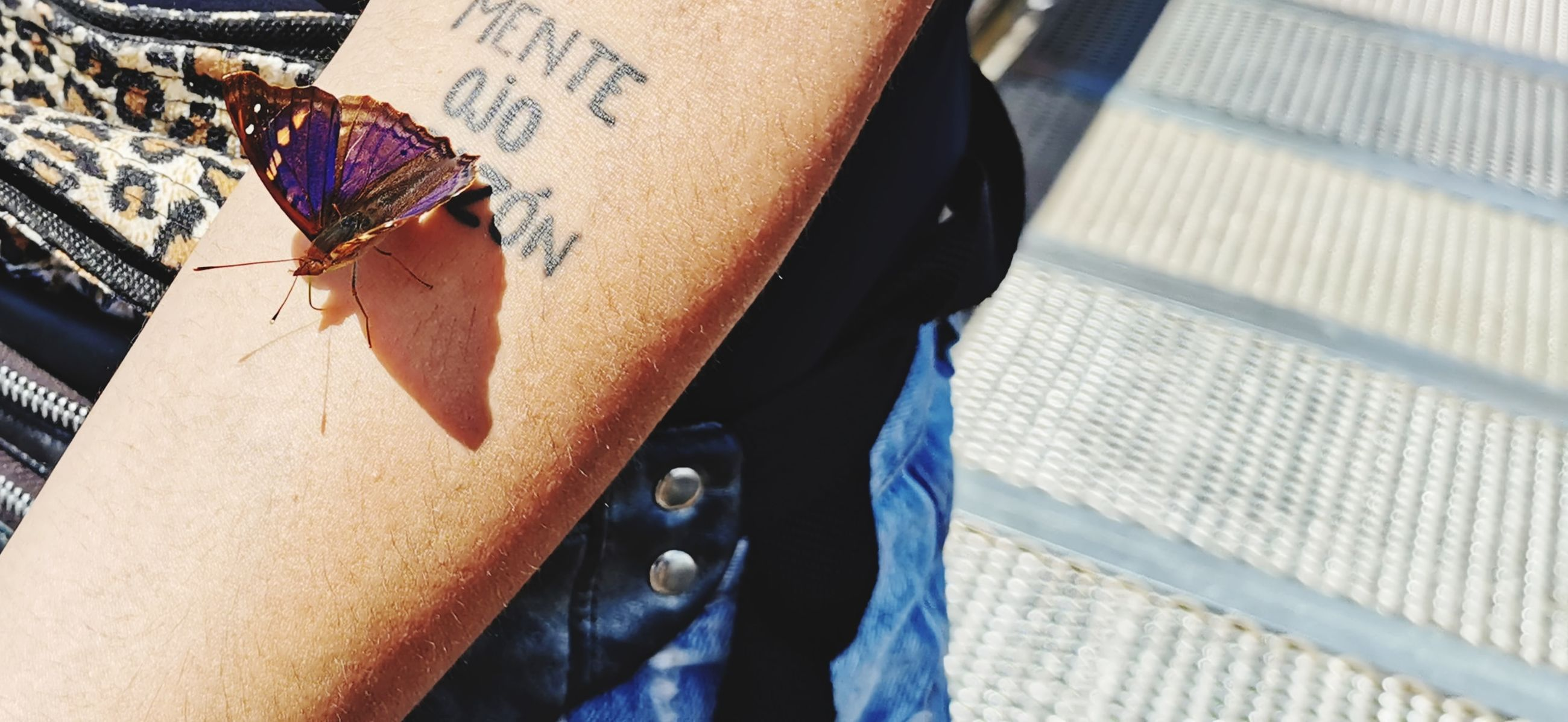 real people, men, midsection, people, day, sunlight, human body part, casual clothing, focus on foreground, lifestyles, body part, outdoors, two people, human hand, human limb, close-up, hand, leisure activity, adult, jeans