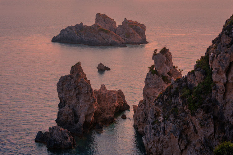 Beauty In Nature Calm Cliff Corfu Greece Idyllic Nature Ocean Outdoors Rock - Object Rock Formation Rocks Sea Sunset Tranquil Scene Tranquility View Water