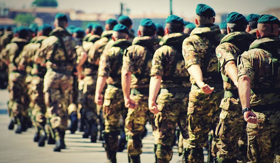 Soldiers - https://youtu.be/0mH23CAV7jE Crowd Group Of People Real People Large Group Of People Day Armed Forces Men Clothing Army Soldier Focus On Foreground Uniform Military In A Row Rear View Army Parade Outdoors Uniform Military Uniform Rear View Camouflage Clothing The Photojournalist - 2018 EyeEm Awards