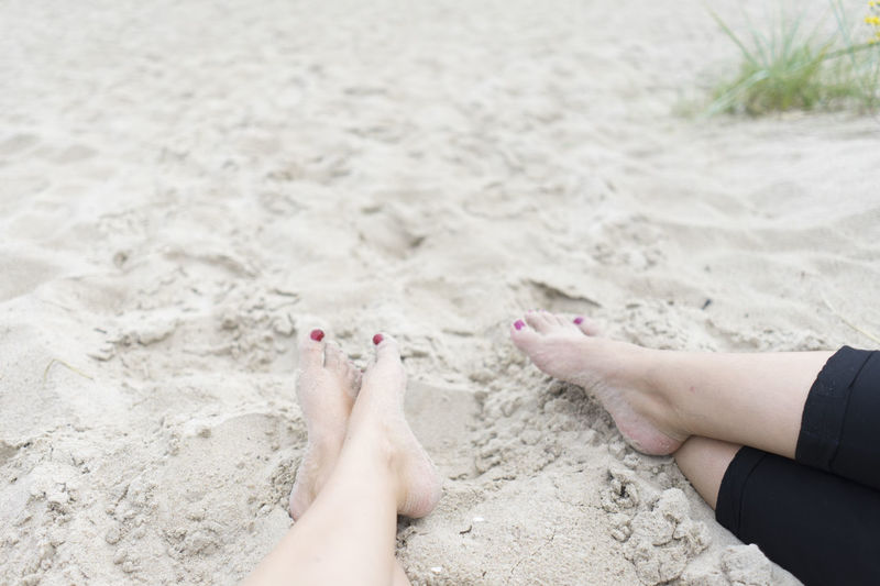 Friends Sandy Feet Adult barefoot Beach Close-up Day Feet Human Body Part Human Foot Human Leg Leisure Activity Lifestyles Low Section Nail Polish Nature One Person Outdoors People Real People Sand Vacations Women