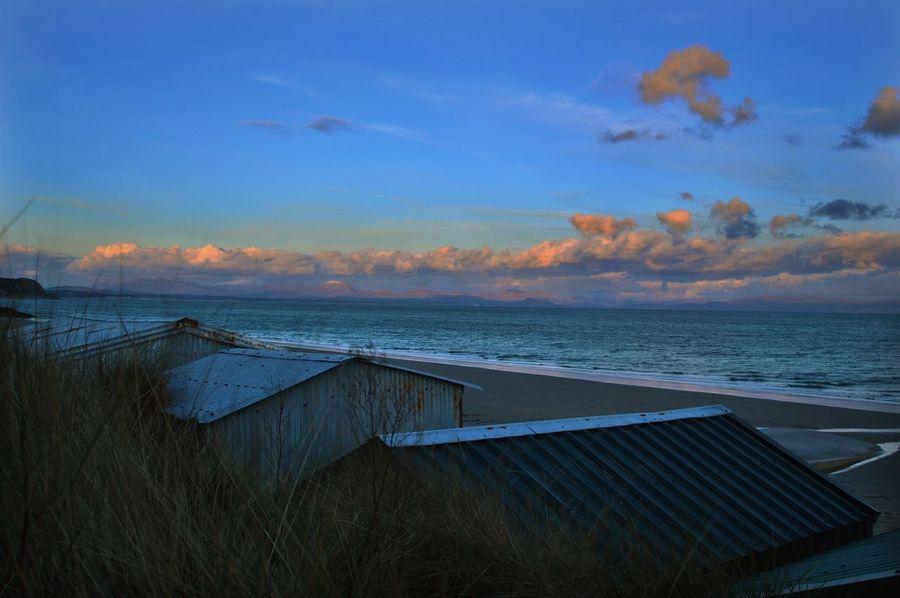 Beach huts of Abersoch. North Wales Sunset #sun #clouds #skylovers #sky #nature #beautifulinnature #naturalbeauty #photography #landscape Beachphotography Beach Beachhut