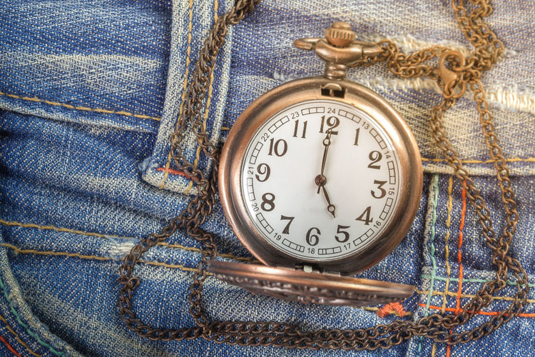 High angle view of clock on jeans