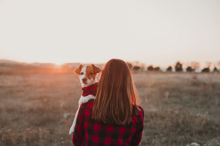 woman and dog at sunset wearing same plaid shirt and bandana. outdoors Mammal One Animal Domestic Animals Domestic Pets Animal Themes Canine Sky Animal Dog Nature Land Real People Standing Sunset Field Casual Clothing Landscape Focus On Foreground Hair Hairstyle Young Adult Beautiful Owner Woman Young Woman Back View Backgrounds Jack Russell Terrier Matching Plaid Red Blackandwhite Bandana Outfit WeAreJux Togetherness Mother Filed Brunette Cute Small Holding Intelligent Obedient Lifestyle Portrait Friendship Autumn