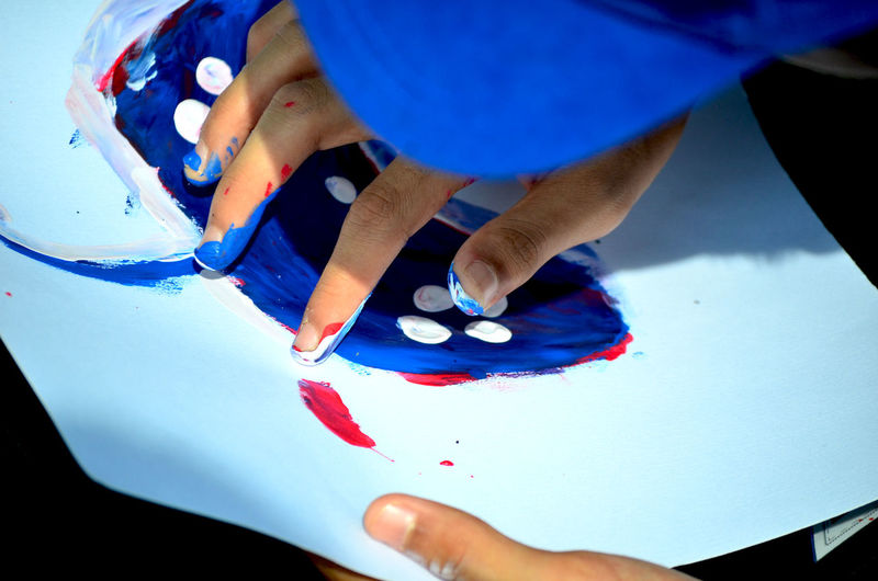 Cropped hands of person making art on paper