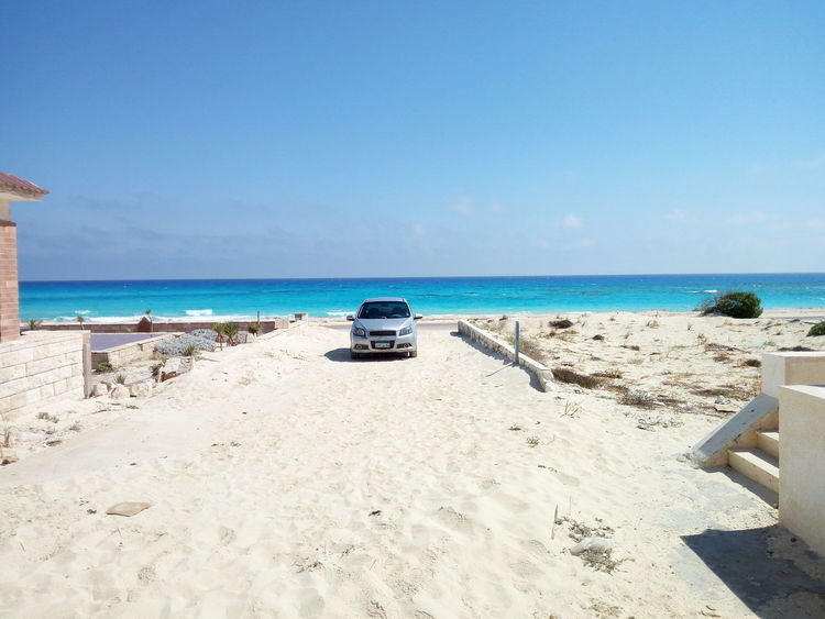EyeEm Selects Beach Sand Sea Horizon Over Water Sunny Tranquility Clear Sky Sky Water Tranquil Scene Day Summer Vacations Travel Destinations Blue Sea Nature Outdoors Sunlight No People Scenics Been There. Marsa Matrouh, Egypt Done That. The Week On EyeEm