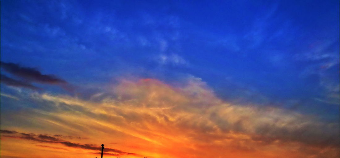 Beauty In Nature Blue Cloud - Sky Dramatic Sky Dusk Idyllic Low Angle View Moody Sky Multi Colored Nature No People Orange Color Outdoors Romantic Sky Scenics - Nature Silhouette Sky Sunset Tranquil Scene Tranquility