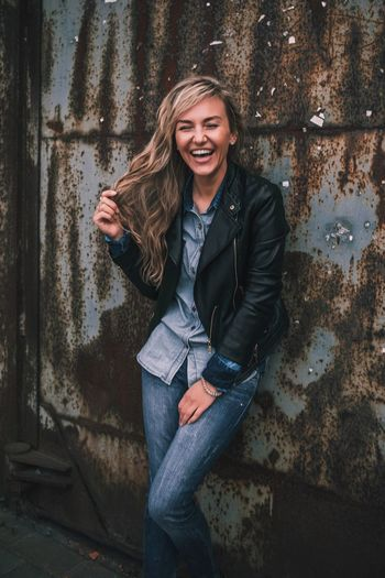 Smiling One Person Happiness Portrait Lifestyles Jacket Jeans Beautiful Woman Toothy Smile Standing