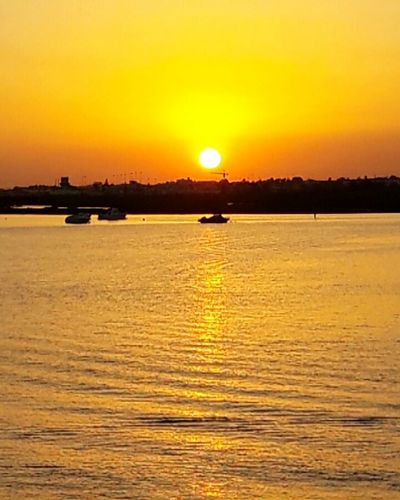 Sunset Water Orange Color Sun Tranquil Scene Sea Vibrant Color Romantic Sky Vacations Tranquility Sunset Water Scenics Orange Color Sun Tranquil Scene Tranquility Waterfront Beauty In Nature Idyllic Sea Nature River Distant Vibrant Color First Eyeem Photo