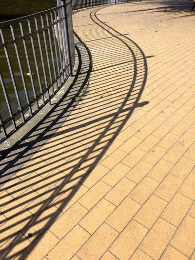 Geometric Shape Pattern No People Outdoors Day Sunlight Shadow Symmetry Railing Park Pond Summer Friedrichshain Sidewalk Sinuous Wavy Lines Parallel Lines Bend Curve