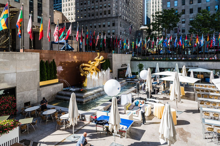 Rockefeller Center Plaza in NYC Manhattan NYC New York New York City Rockefeller Center Rockefeller Plaza Architecture Building Building Exterior Built Structure City City Life Day Group Of People High Angle View Incidental People Large Group Of People Men Nature Outdoors Plaza Real People Street Water
