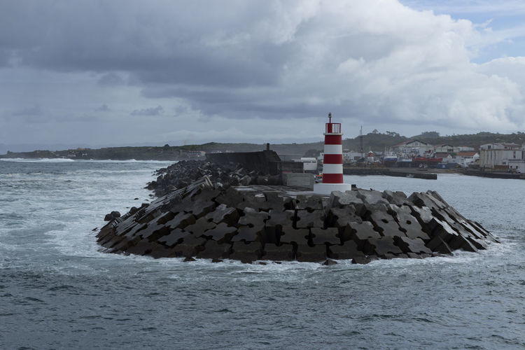 Azores Azores Islands The Week On EyeEm Architecture Azores, Pico Beach Beauty In Nature Building Exterior Built Structure Cloud - Sky Day Groyne Guidance Horizon Over Water Lighthouse Nature No People Outdoors Pico Protection Scenics Sea Tranquility Water Waterfront