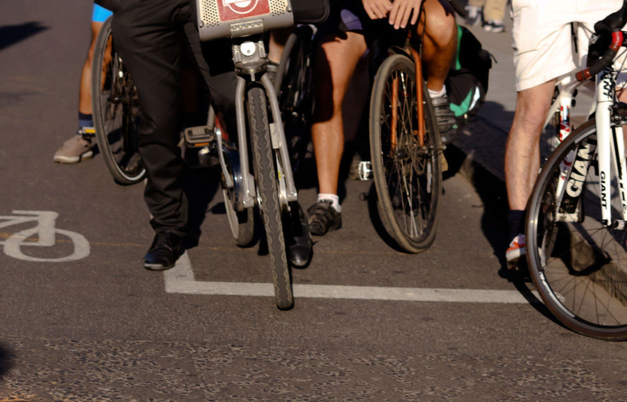 Cycling for work, cycling for life. CyclingUnites London Transport Transportation Bicycle City Cycling Group Of People Low Section Move Real People Road Road Marking Street Street Art Street Photography Streetphotography Transportation