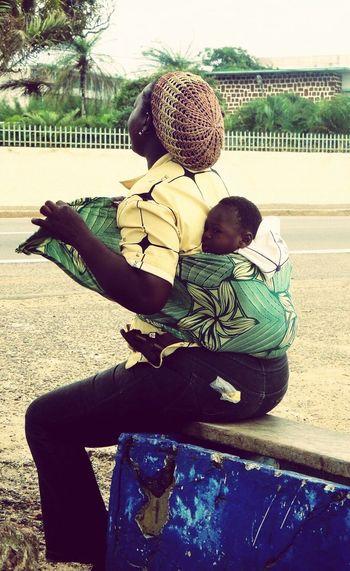 Motherhood connection Motherlove Childhood Flying On The Back Libreville-Gabon Africa