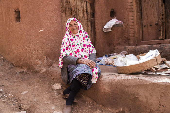 She is Omol Kolsom, she was 75 years old and she sold her hand made like vinegar and slice of apples dry , bathroom staff and washcloths.she was so happy person even she was not rich person. Abyaneh Clothes Dress Iran Iranian Iranian People One Person Outdoors People Real People The Great Outdoors - 2017 EyeEm Awards The Photojournalist - 2017 EyeEm Awards The Portraitist - 2017 EyeEm Awards Traditional Clothing Traditional Costume Women Place Of Heart Press For Progress