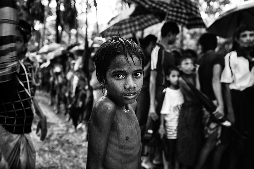 A Rohingya refugee. Over the last couple of weeks, more than 700,000 Rohingya people flooded into Bangladesh. As they forced to flee Myanmar. A Genocide that is happening in front of everyone in open broad light. Myanmar army killing Rohingya people, torched their house, raped their women and childrens. Rohingya peoples considered to be the most persecuted peoples in the world. Their journey from Myanmar to Bangladesh was more horrible and painstaking. People walked sleepless night miles after miles through hill, river,muddy track. Many people died and many babies born on the way. Adult Bangladesh Children Documentary Photography Genocide JournalismPhotography Journalist Life Press Refugee Rohingya Refugees The Photojournalist - 2018 EyeEm Awards Animal Documantry Journalism Mynmar Outdoors Photography Press Photo Refugee Crisis Refugees