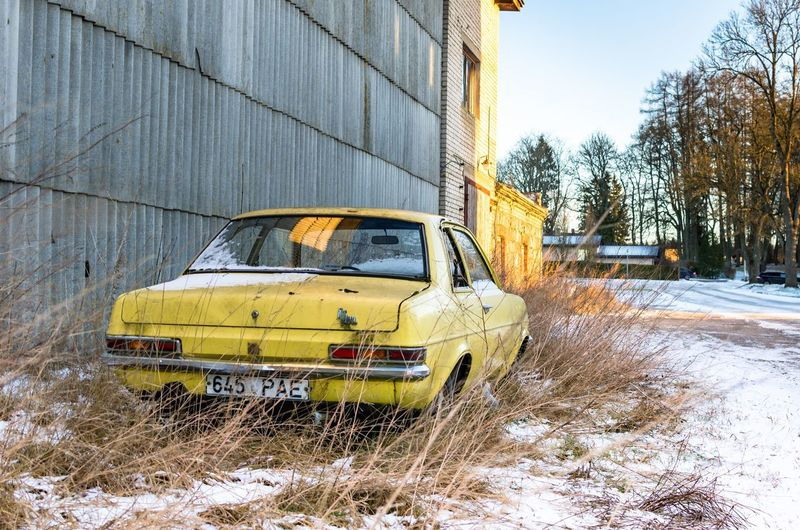 """""""How dull it is to pause, to make an end, To rust unburnished, not to shine in use."""" An abandoned car by the wayside. Yellow Car Automobile Small Car Building Derelict Neglected Thrown Away Rusting Away Automobile HC Series Vauxhall Viva Vauxhall Car Wall Grass Frost Wayside Road Abandoned Buildings Abandoned Places Snow Winter Yellow Transportation Car Cold Temperature Outdoors Day No People Building Exterior"""