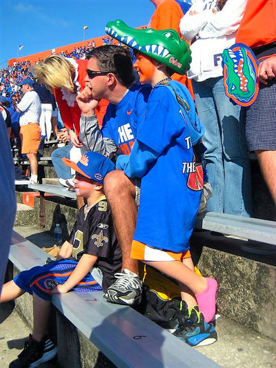 Blue Color Connected By Travel Football Gators Orange Stadium UF Adult Boys Childhood Day Full Length Men Outdoors People Real People Standing Togetherness University Of Florida Volunteer Women