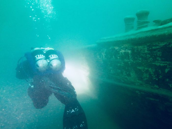 Scuba Diver By Wrecked Ship