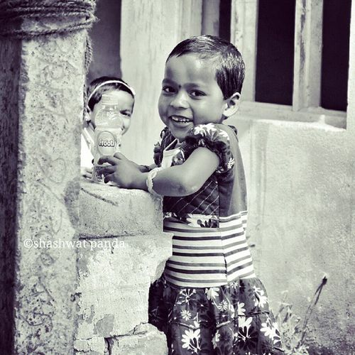 Hide and seek... 😊 Portrait of a Child , on the Streets of Bhubaneswar , Odisha Blackandwhitephotography Bnw_captures Canon1100d Perfocal