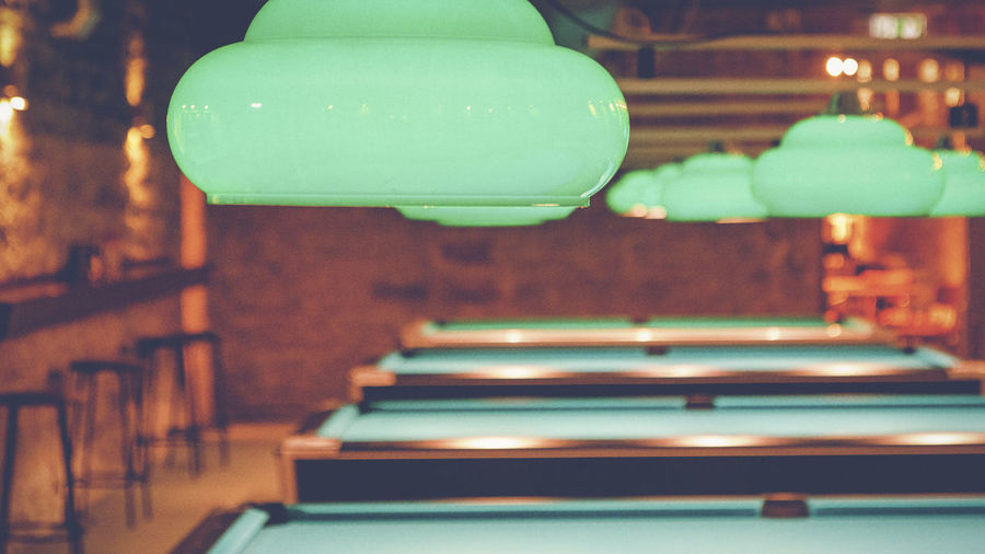 Close-Up Of Pendant Lights Above Pool Tables
