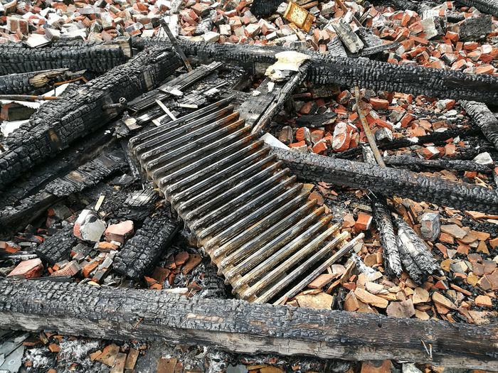 High Angle View Of Burnt Wood On Field