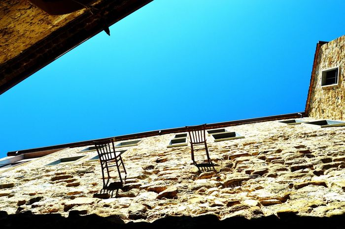 Day Sunny Clear Sky Outdoors No People Architecture Low Angle View Chair In The Air Object Old Town Break The Mold Art Is Everywhere TCPM Break The Mold The Street Photographer - 2017 EyeEm Awards EyeEmNewHere