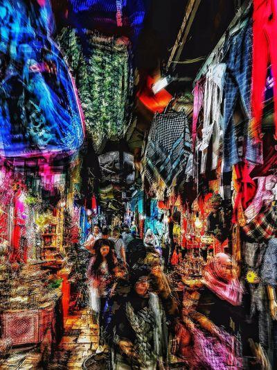 Illuminated street market in city at night