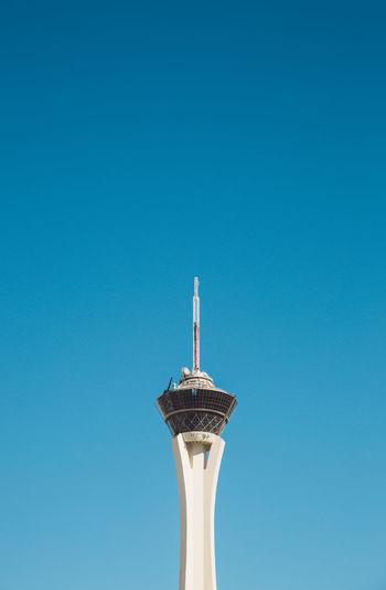 Low angle view of stratosphere against clear blue sky during sunny day