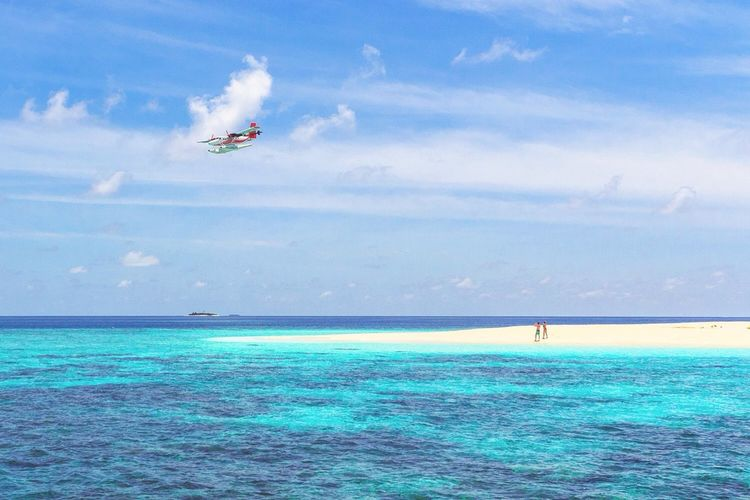 Fly somewhere amazing! Horizon Over Water Sea Sky Flying Water Waterfront Air Vehicle Beach Tranquil Scene Travel Photography