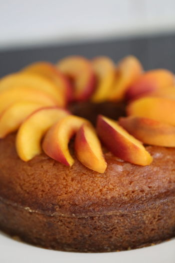 Close-up of peaches garnished on cake