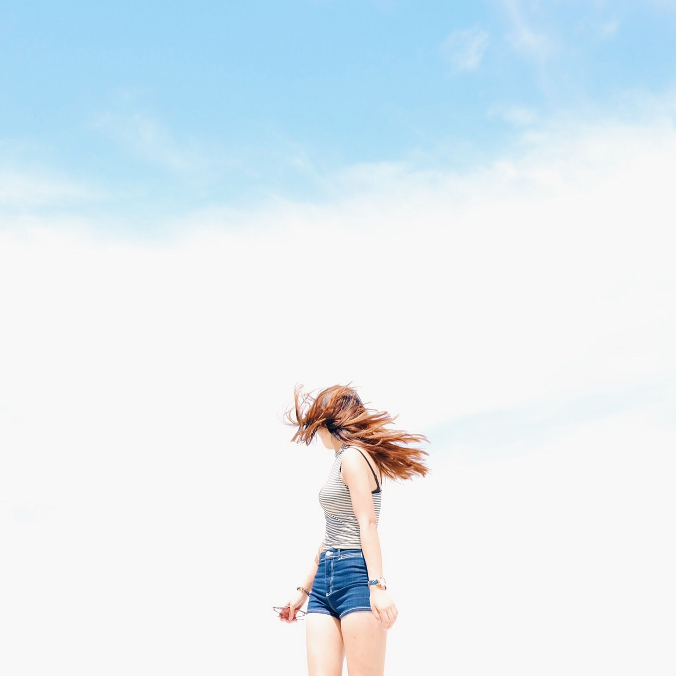 lifestyles, sky, leisure activity, person, standing, holding, rear view, copy space, nature, long hair, low angle view, dandelion, three quarter length, waist up, flower, outdoors