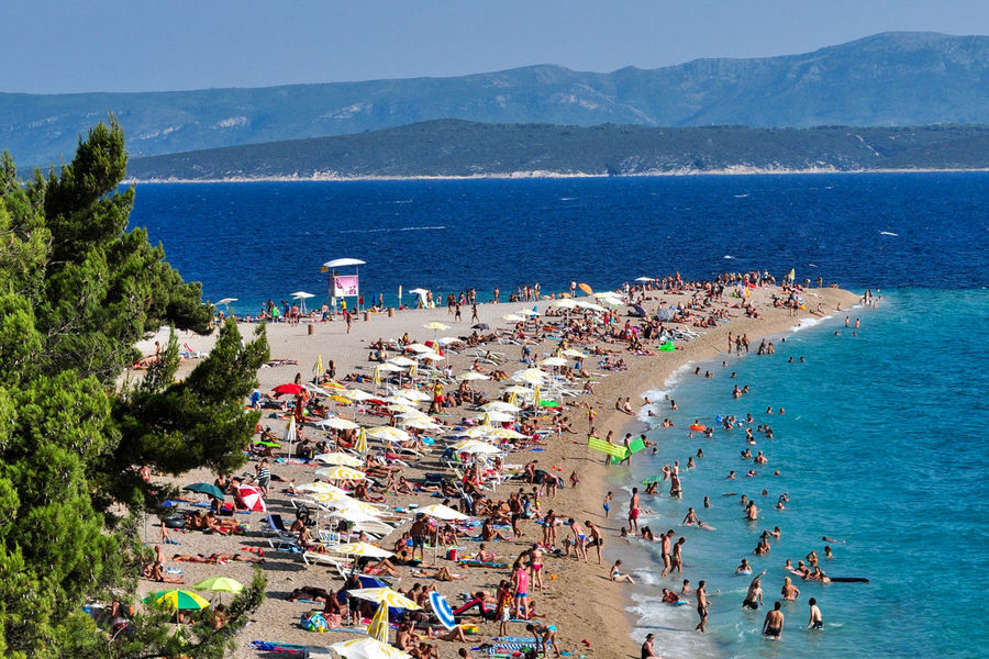 Adult Beach Beautiful Beauty Beauty In Nature Beauty In Nature Bol Croatia Crowd Day Golden Horn High Angle View Large Group Of People Mountain Nature Outdoors People Sea Tree Vacations Water Water Reflections Wave Zlatni Rat