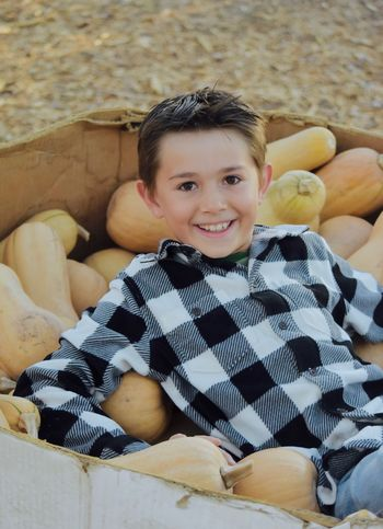 Country boy life Autumn Collection Children Country Living Farm Boy Gardening Harvest Season Lifestyle Squashes Young Boys Childhood Children Only Country Life Farm Concepts And Images Farming Happy Children Working Harvesting Season Lifestyles One Person Organic Gardens And Gardening Outdoors People Popular Photos Real Life Smiling