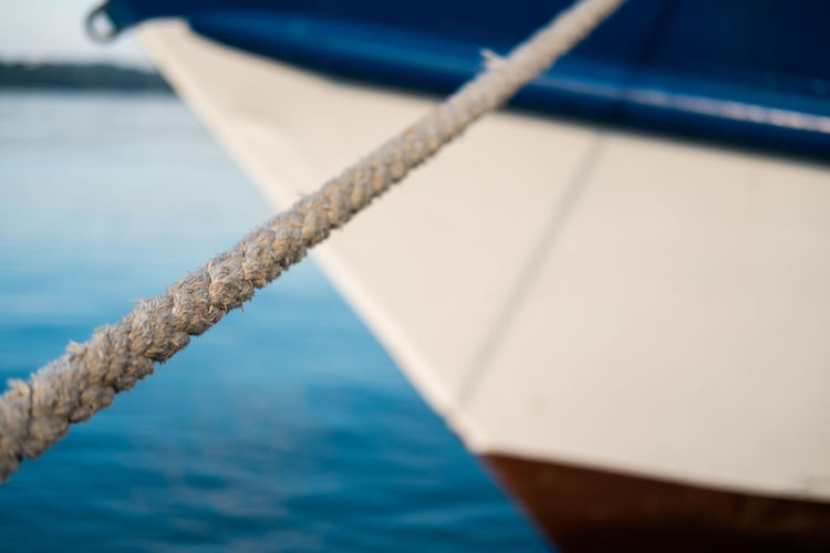 Old wooden fisherman boat Water Nautical Vessel Rope Sea Transportation No People Strength Mode Of Transportation Focus On Foreground Day Nature Sailboat Ship Close-up Selective Focus Sailing Tied Up Outdoors Yacht Moored Seaside Boat Old Wooden Boat Harbour Nautical Theme Travel Destinations Fisherman Boat