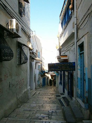 Architecture Building Exterior Built Structure The Way Forward Residential Building Outdoors Day Lane Sky City No People Tunisia Tunis Contrast City Street Photography Oriental Light Colors Town Cultures Street Blue Culture Travel Destinations