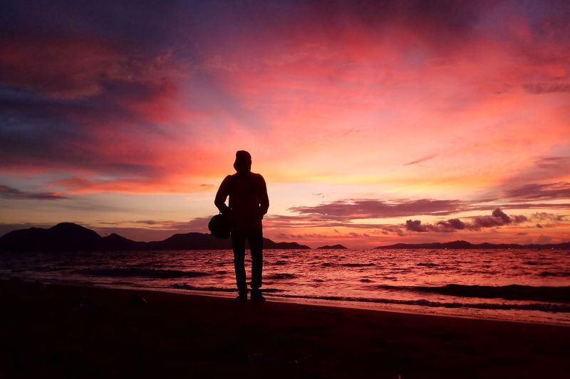Aceh Culture Aceh INDONESIA Sunset Photography Water Politics And Government Full Length Sunset Sea Beach Back Men Silhouette Red Seascape Sand Dune Place Of Worship Cathedral Shore Catholicism Dramatic Sky Human Back Romantic Sky Low Tide Horizon Over Water Coast Tide Coastline Moody Sky