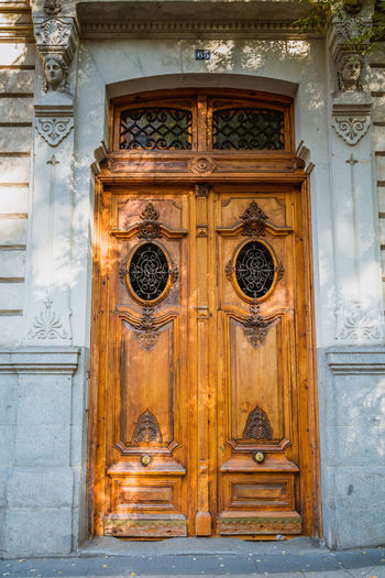 Architecture Art And Craft Building Exterior Built Structure Carved Wood Closed Design Door Doorway Entrance Front Door Historic Madrid Main Entrance No People Old Old Door Ornate Safety Streetphotography Wood Wood Wood - Material Wooden Wooden Door
