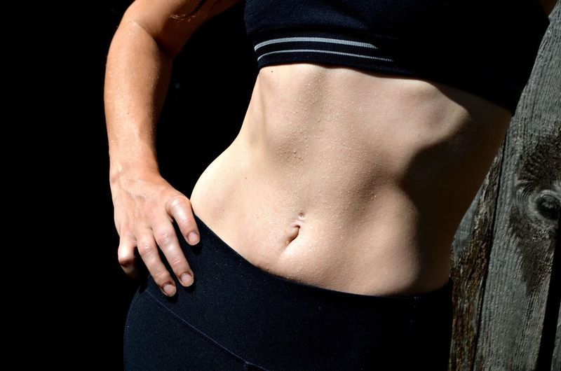 Midsection Of Woman With Sweaty Abdomen