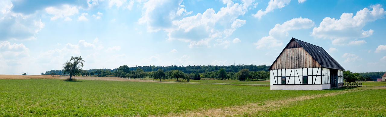 A traditional barn in a rural area of Bavaria, germany. EyeEmNewHere Agriculture Farm Life Panorama Panoramic View Rustic Agriculture Photography Building Exterior Cloud - Sky Cottage Grass Landscape Outdoors Panoramic Landscape Rural Landscape Rural Life Rural Scene Rustic Beauty Traditional Tranquil Scene