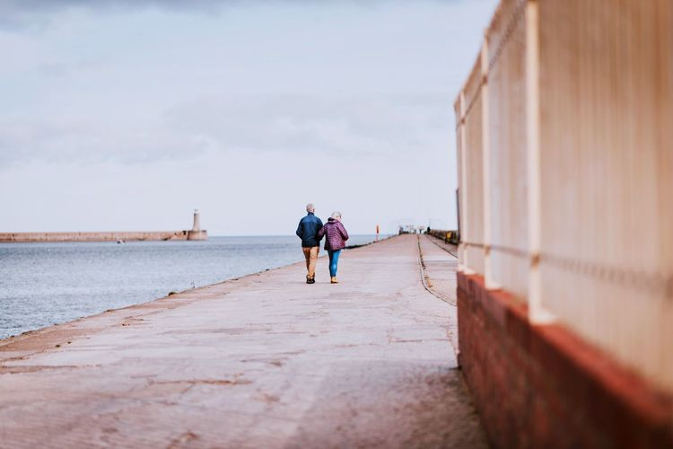 Walk along the pier Nikon Nikonphotography EyeEm Gallery EyeEm Masterclass Pier Men Water Lifestyles Leisure Activity Rear View Real People Women Two People Nature Togetherness Full Length Outdoors Sky Sea Day Adult Walking People