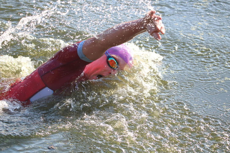 Man Ripples TRIATHLON Day Front Crawl High Angle View Lake Leisure Activity Lifestyles Motion Nature One Person Outdoors Real People Splashing Sport Swimming Triathlete Water Waterfront
