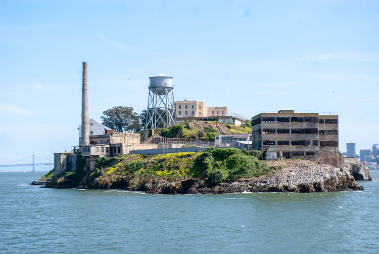 Alcatraz Alcatraz Island Built Structure Architecture Building Exterior Water Sky Waterfront Nature Day Sea Industry No People Factory Building Smoke Stack Outdoors Clear Sky Fuel And Power Generation Land Pollution